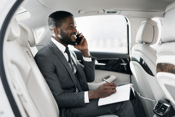 Cheerful African Businessman Chatting On Phone Working Sitting In Car - Stock Photo - Images
