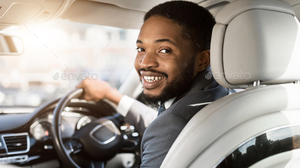 Cheerful Black Man Driving Automobile Sitting In Driver's Seat, Panorama - Stock Photo - Images
