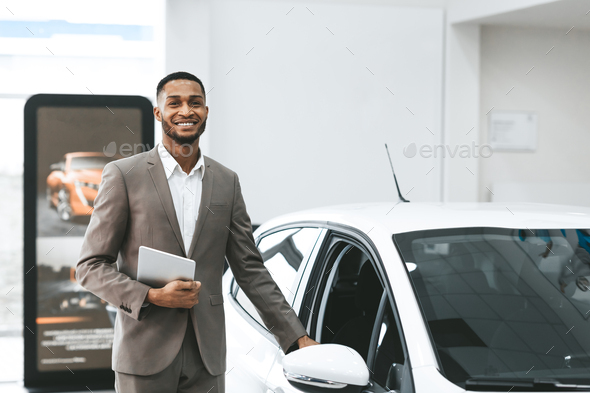 Automobile Seller Man Opening Car Door Standing In Dealership Shop - Stock Photo - Images