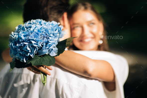 Happy Newlyweds Couple Hugging Standing During Marriage Ceremony In Park - Stock Photo - Images