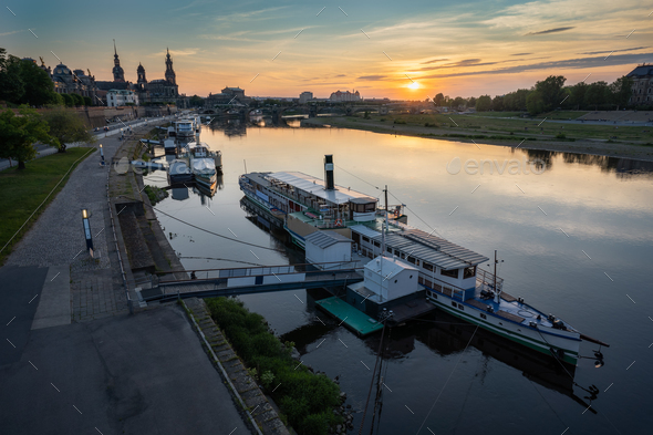 Beautiful Dresden city skyline at Elbe River and tourism pleasure steamship on pier, Dresden, Saxony - Stock Photo - Images