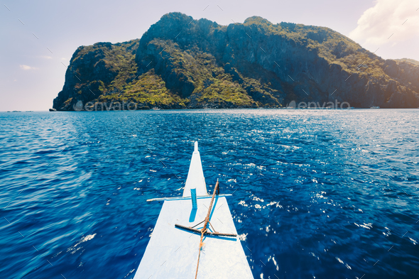 El Nido, Philippines. Front of Island hopping Tour boat hover over open blue ocean water facing - Stock Photo - Images