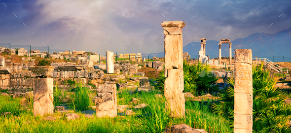 Panorama of ancient city of Hierapolis with statue of Pluto in Pamukkale - Stock Photo - Images