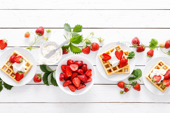 Traditional belgian waffles with cream cheese and fresh strawberry on white background - Stock Photo - Images