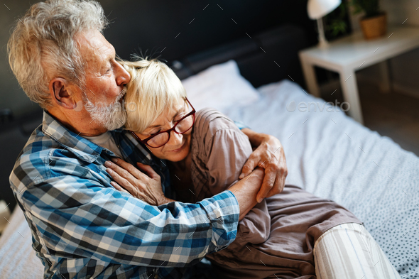 Happy senior couple in love hugging and bonding with true emotions at home - Stock Photo - Images