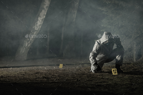 Crime Evidence Markers Placing by Forensic Officer - Stock Photo - Images