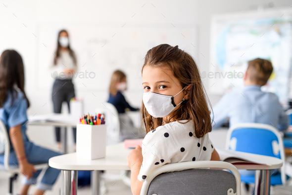Child with face mask back at school after covid-19 quarantine and lockdown - Stock Photo - Images