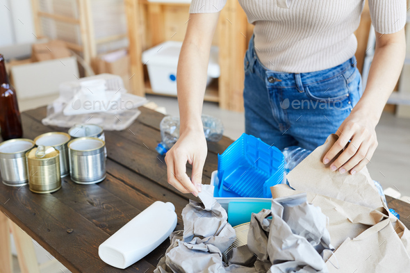 Woman working with waste - Stock Photo - Images