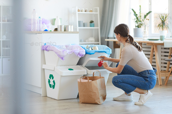 Woman sorting garbage in the kitchen - Stock Photo - Images