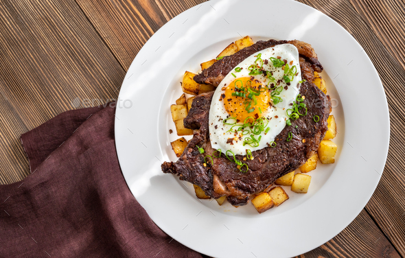 Beefsteak with fried egg - Stock Photo - Images