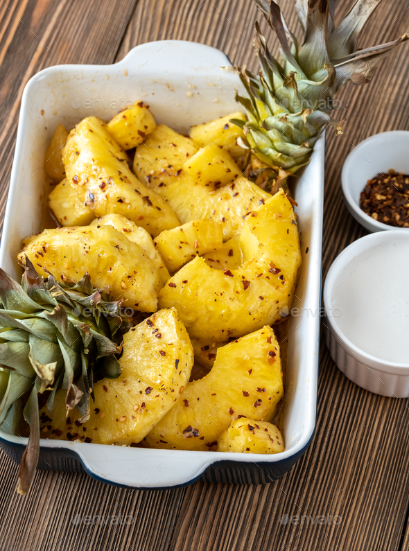 Baked pineapple with chilli flakes - Stock Photo - Images