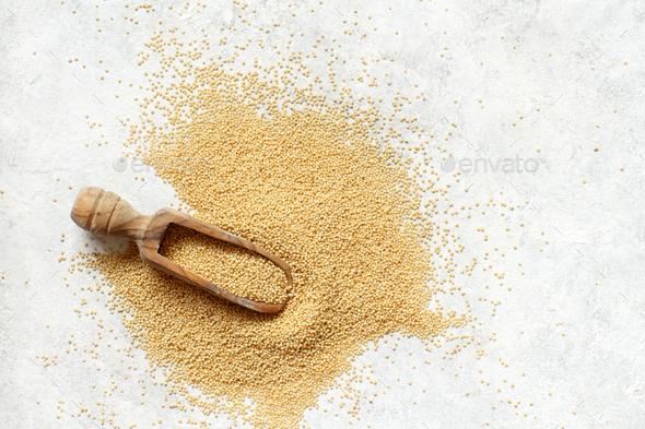 Scoop of Raw Amaranth Grain - Stock Photo - Images