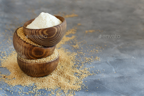 Bowls of raw Amaranth flour and seeds - Stock Photo - Images
