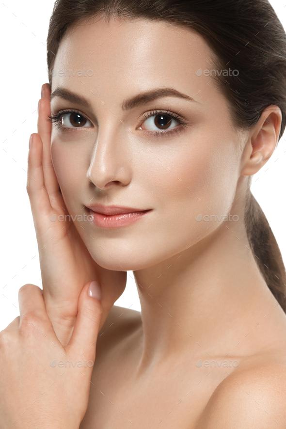 Beautiful skin face woman brunette hair natural makeup plastic surgery. Studio shot. - Stock Photo - Images