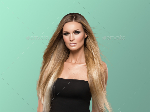 Woman smooth hair blonde lond beauty natural casual portrait. On blue. - Stock Photo - Images