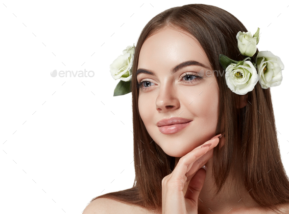 Woman with flowers in hair beautiful portrait long amazing hair. Isolated white. Studio shot. - Stock Photo - Images