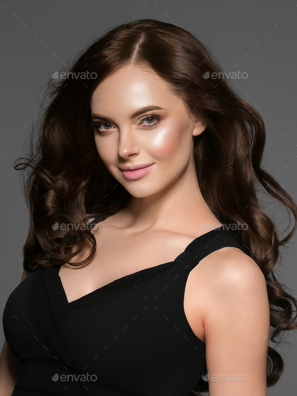 Beautiful woman with long beauty hair black dress glamour fashion female portrait. Studio shot. - Stock Photo - Images