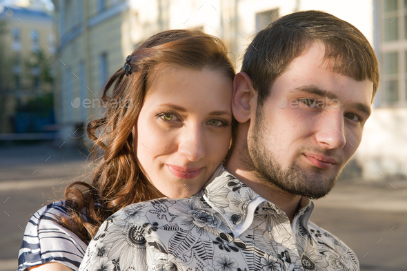 Young fashion couple walking down the street in summer. Pretty beautiful woman in stripes  clothes. - Stock Photo - Images