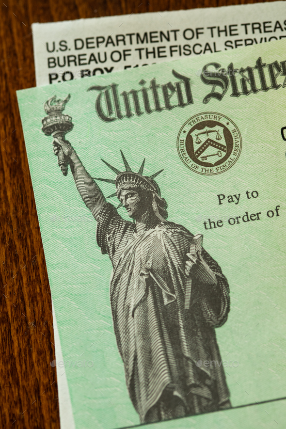 United States Internal Revenue Service, IRS, Check and Corner of Envelope - Stock Photo - Images