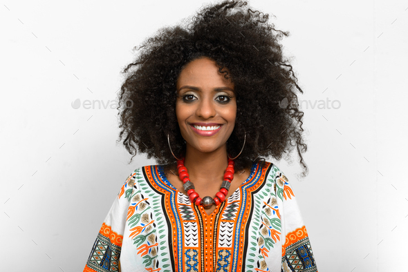 Young beautiful African woman with Afro hair wearing traditional clothes - Stock Photo - Images