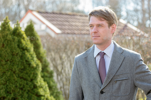 Handsome Scandinavian businessman with blond hair outdoors - Stock Photo - Images