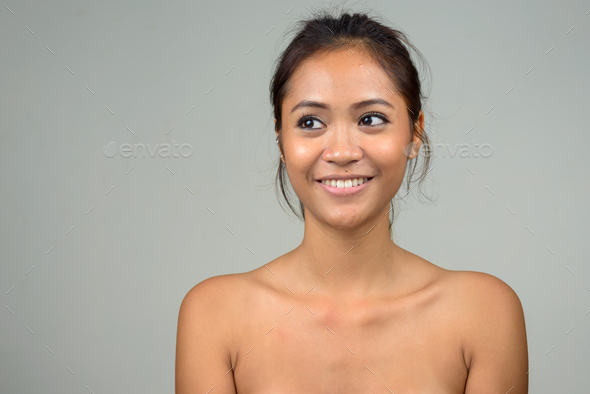 Portrait of young beautiful Asian woman - Stock Photo - Images