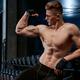 Shirtless bodybuilder posing in gym - PhotoDune Item for Sale