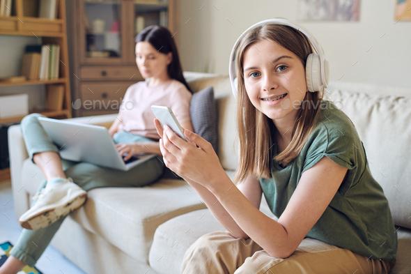 Modern teenager in wireless headphones - Stock Photo - Images