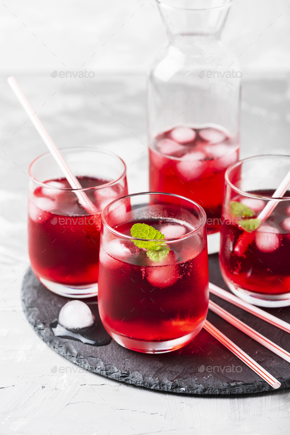 Red alcoholic coctail with ice and mint - Stock Photo - Images