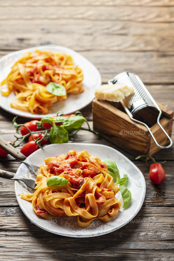 pasta fettuccine with tomato and basil - Stock Photo - Images