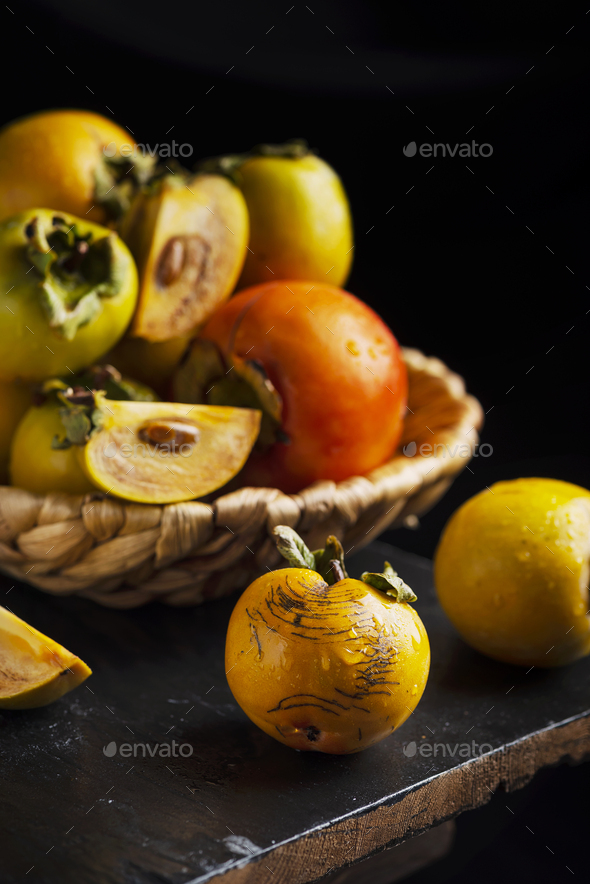 Sweet small persimmons - Stock Photo - Images