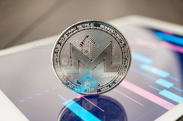 Monero Cryptocurrency On The Tablet - Stock Photo - Images