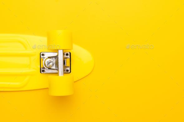 Skateboard On Yellow Background - Stock Photo - Images