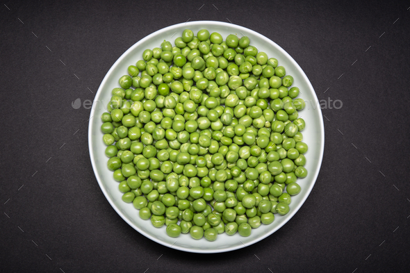 Top view of a plate with fresh Green pea - Stock Photo - Images