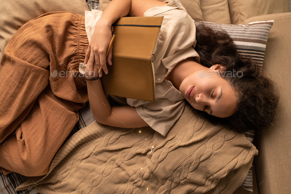 Sleeping with book - Stock Photo - Images