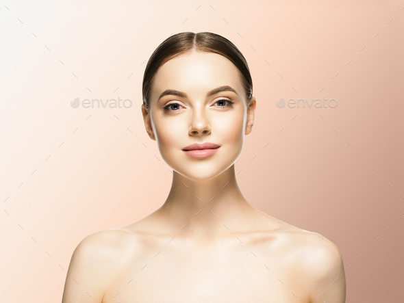 Woman face beauty healthy skin natural makeup beautiful female beige background - Stock Photo - Images
