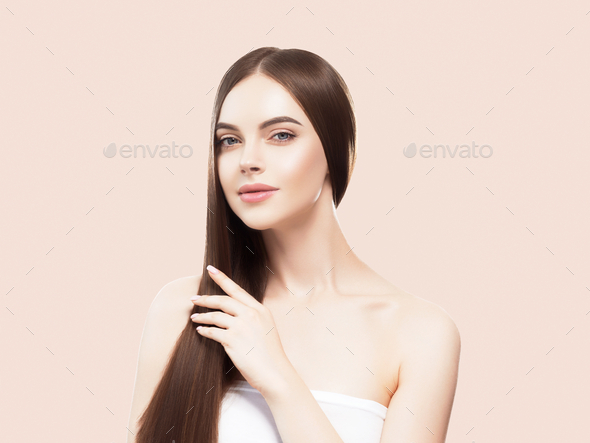 Beautiful freckles woman healthy skin  hair long smooth brunette hairstyle cosmetic concept On beige - Stock Photo - Images