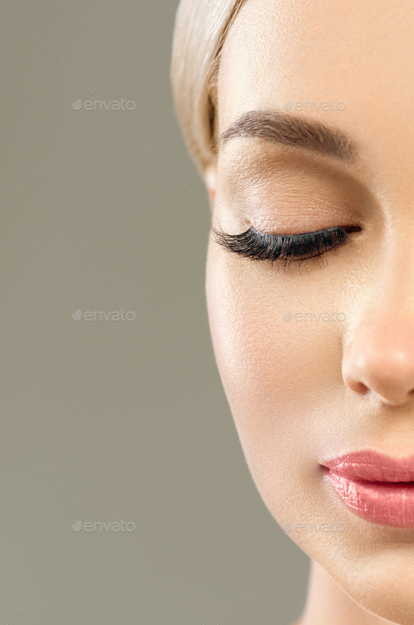 Beautiful blonde hair woman pink lipstick eyelashes beauty face close up portrait. Gray background. - Stock Photo - Images