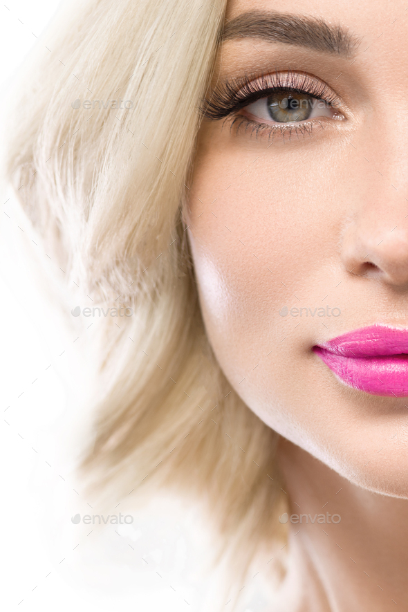 Blonde woman lashes with long curly flying hairstyle  pink lipstick isolated on white. Studio shot. - Stock Photo - Images
