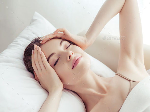Woman sleep home in bed  head ache relax lifestyle - Stock Photo - Images