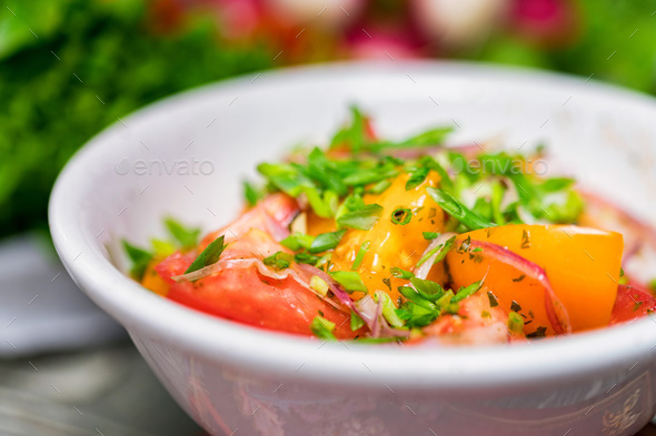 Fresh rustic vegetable salad on rustic background - Stock Photo - Images