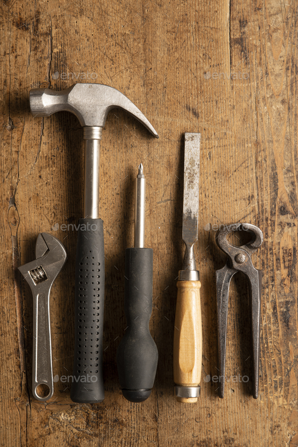 Different tools on a wooden vintage background - Stock Photo - Images
