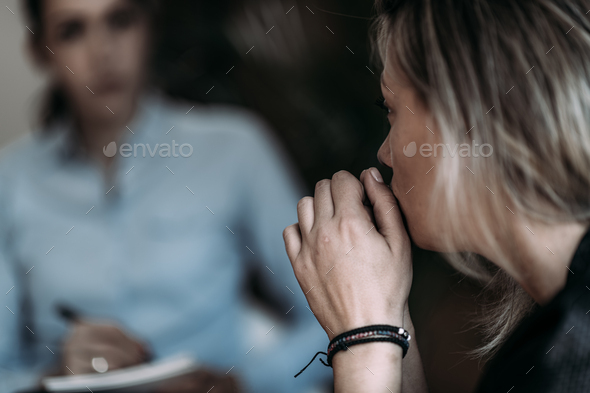 Female PTSD Patient Talking with Psychotherapist. - Stock Photo - Images