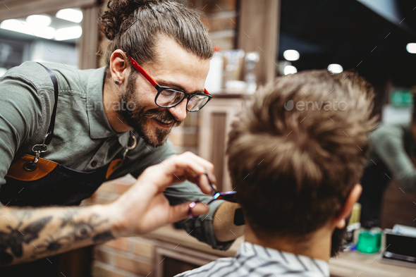 Client during beard and moustache grooming in barber shop - Stock Photo - Images