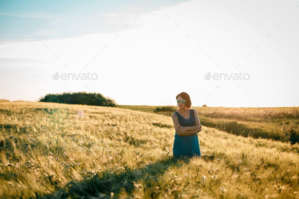 Happy woman enjoying the life in the golden field - Stock Photo - Images