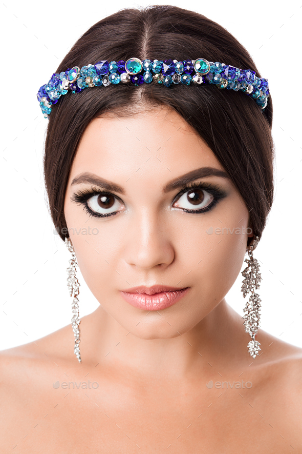 Portrait of beautiful brunette woman with big earring and shinny accessories in hair. Perfect arabic - Stock Photo - Images