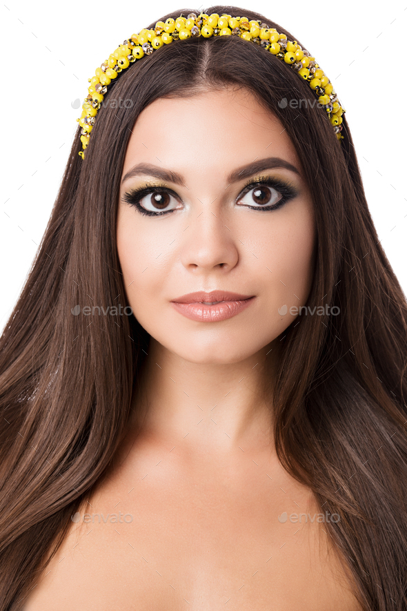 Portrait of beautiful brunette woman with big earring and shinny yellow accessories in hair. Perfect - Stock Photo - Images
