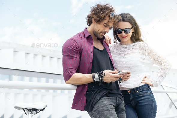 Happy Couple friendship with mobile phone. - Stock Photo - Images