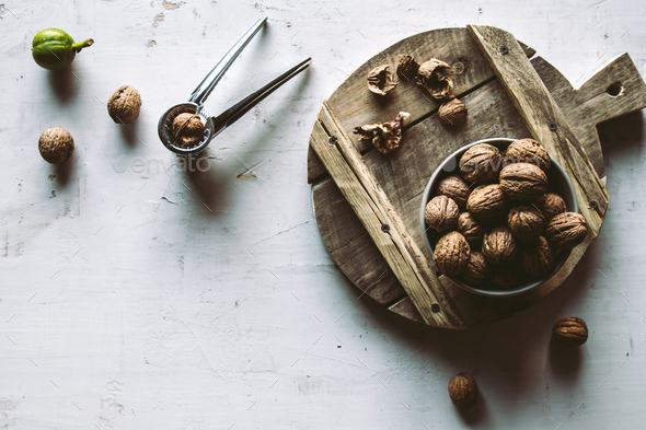 Walnuts in wooden bowl on table with Nutcracker - Stock Photo - Images