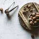 Walnuts in wooden bowl on table with Nutcracker - PhotoDune Item for Sale